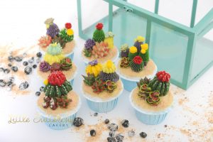 hand piped buttercream cacti cupcakes