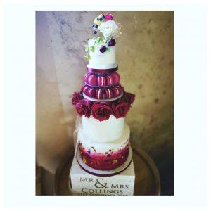 Deep burgundy wedding cake with sugar roses