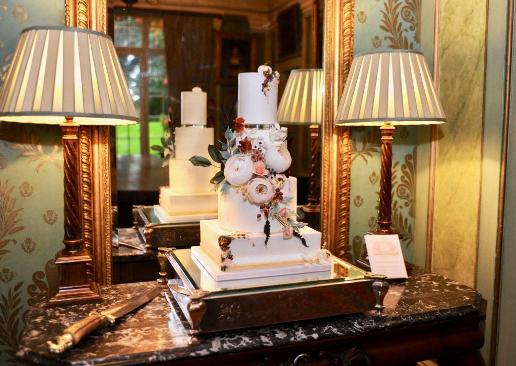 Autumn wedding cake adorned with sugar flowers