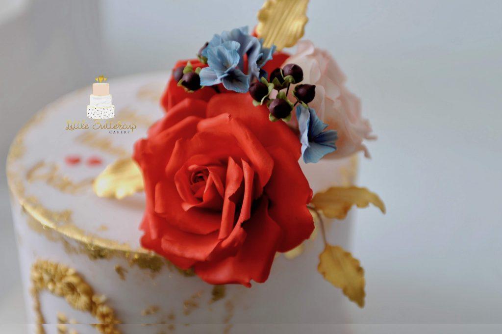 Blush gold and red birthday cake