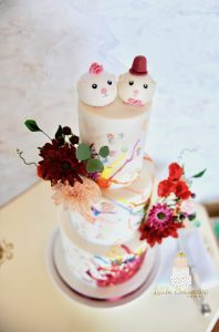 Whimsical Mr. and Mrs. Piggy wedding cake