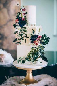 Tropical wedding cake adorned with sugar flowers