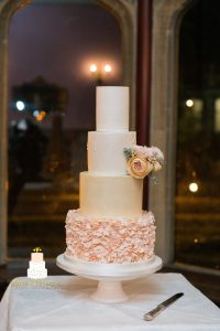 Blush peach ruffle and light gold wedding cake