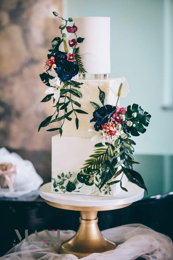 Tropical wedding cake adorned with sugar flowers