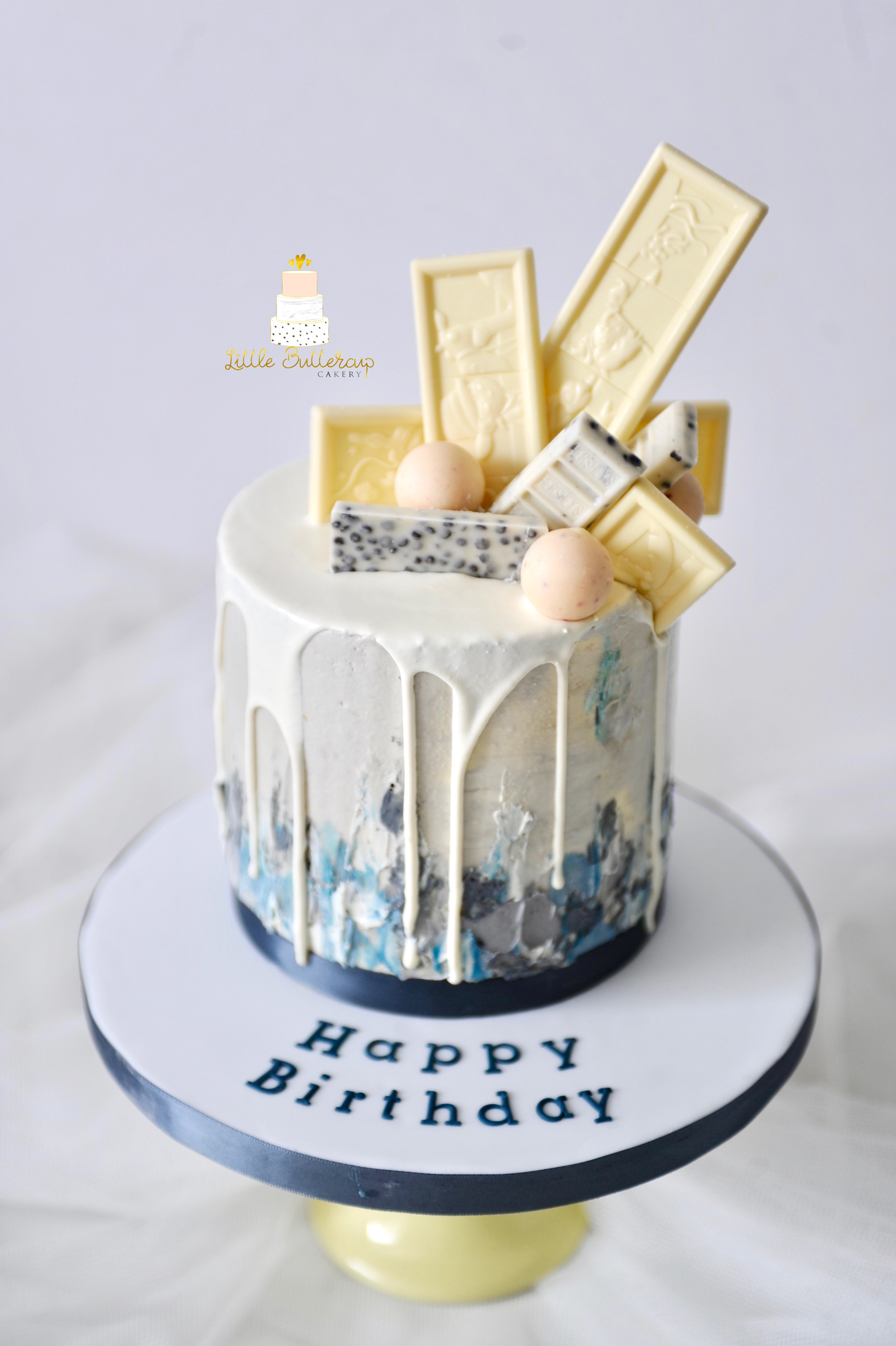 Buttercream drip cake with chocolate bar toppers