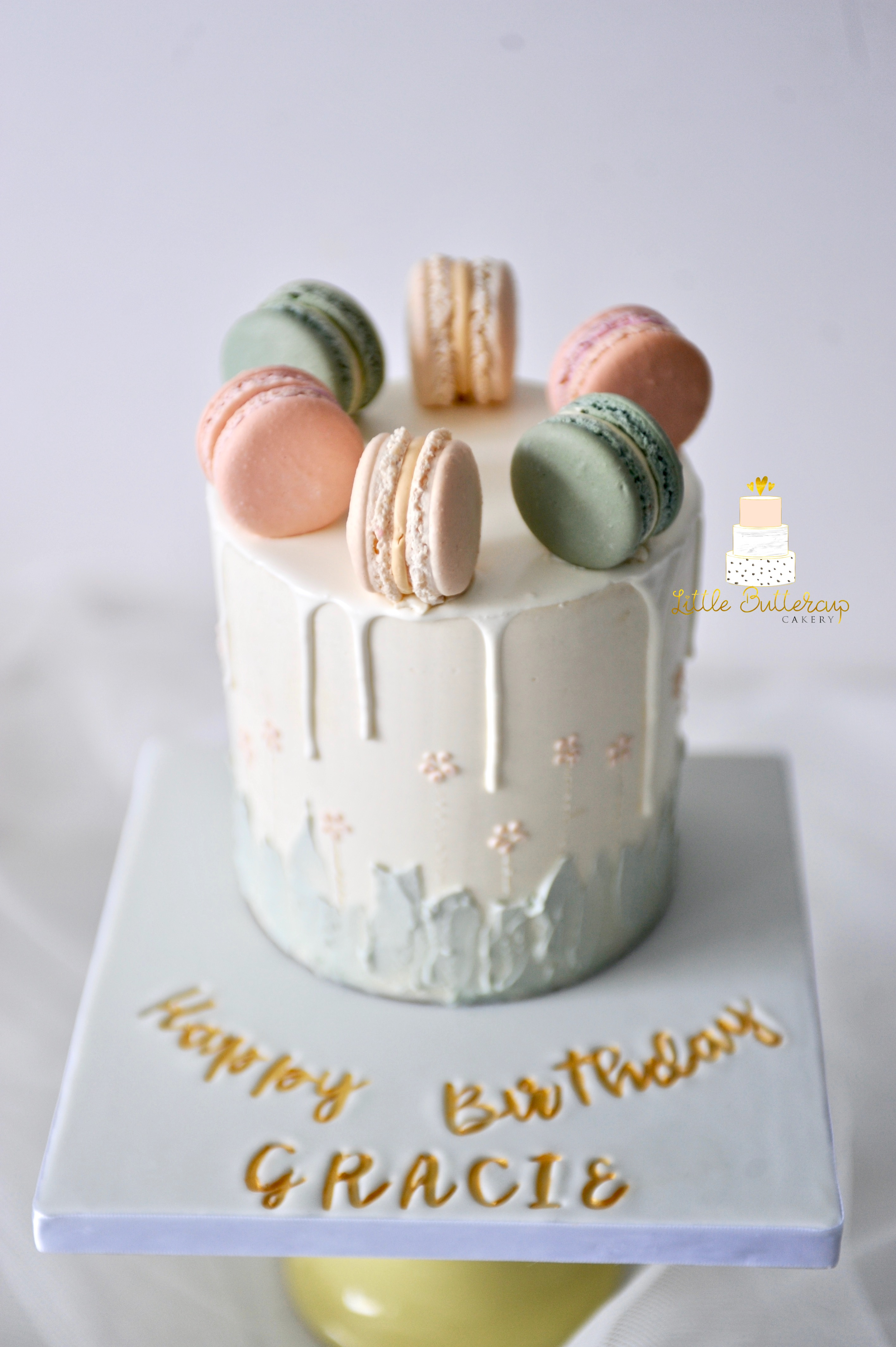 Buttercream drip cake with macaron toppers