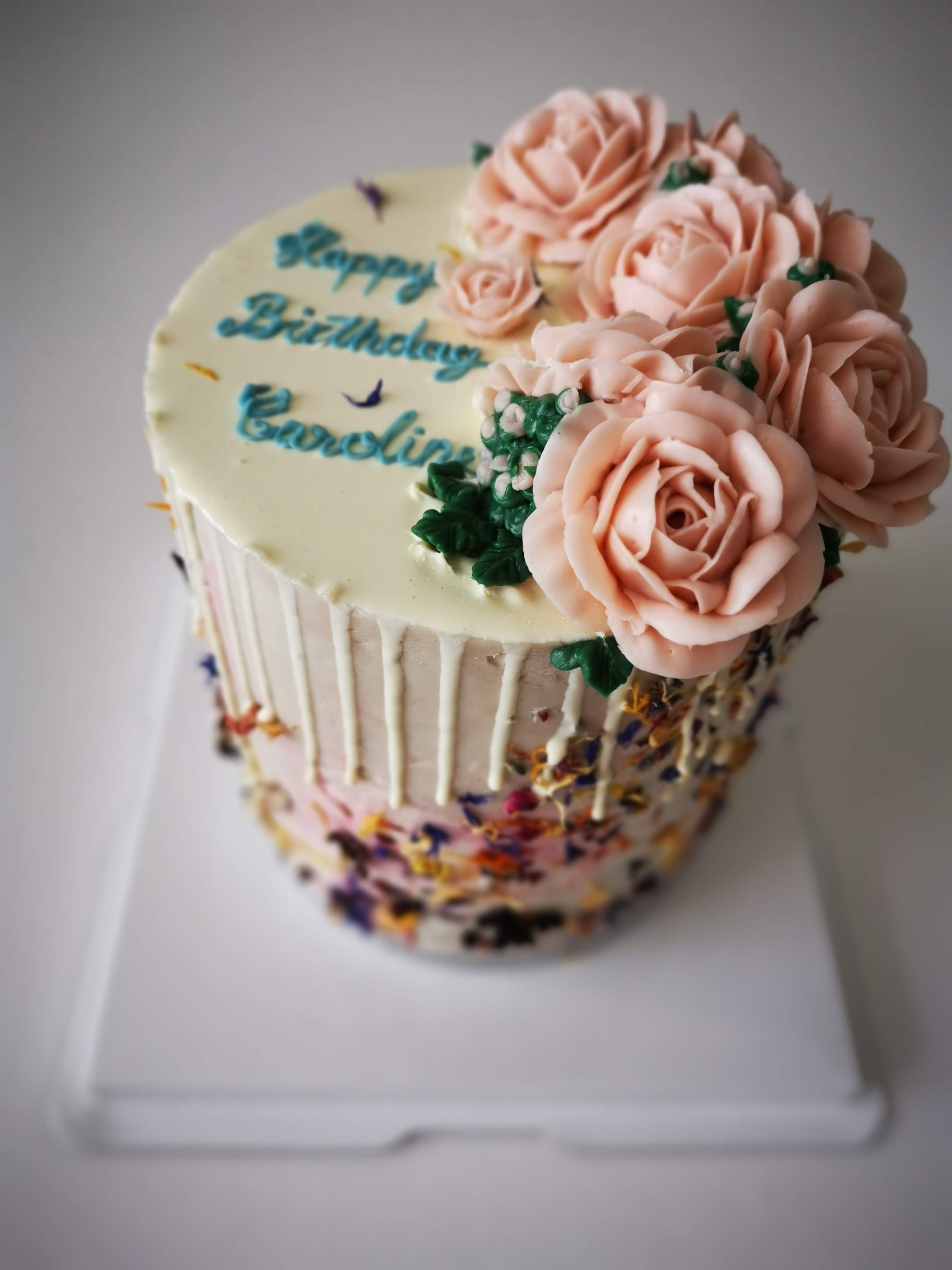 Buttercream drip cake with buttercream piped flowers