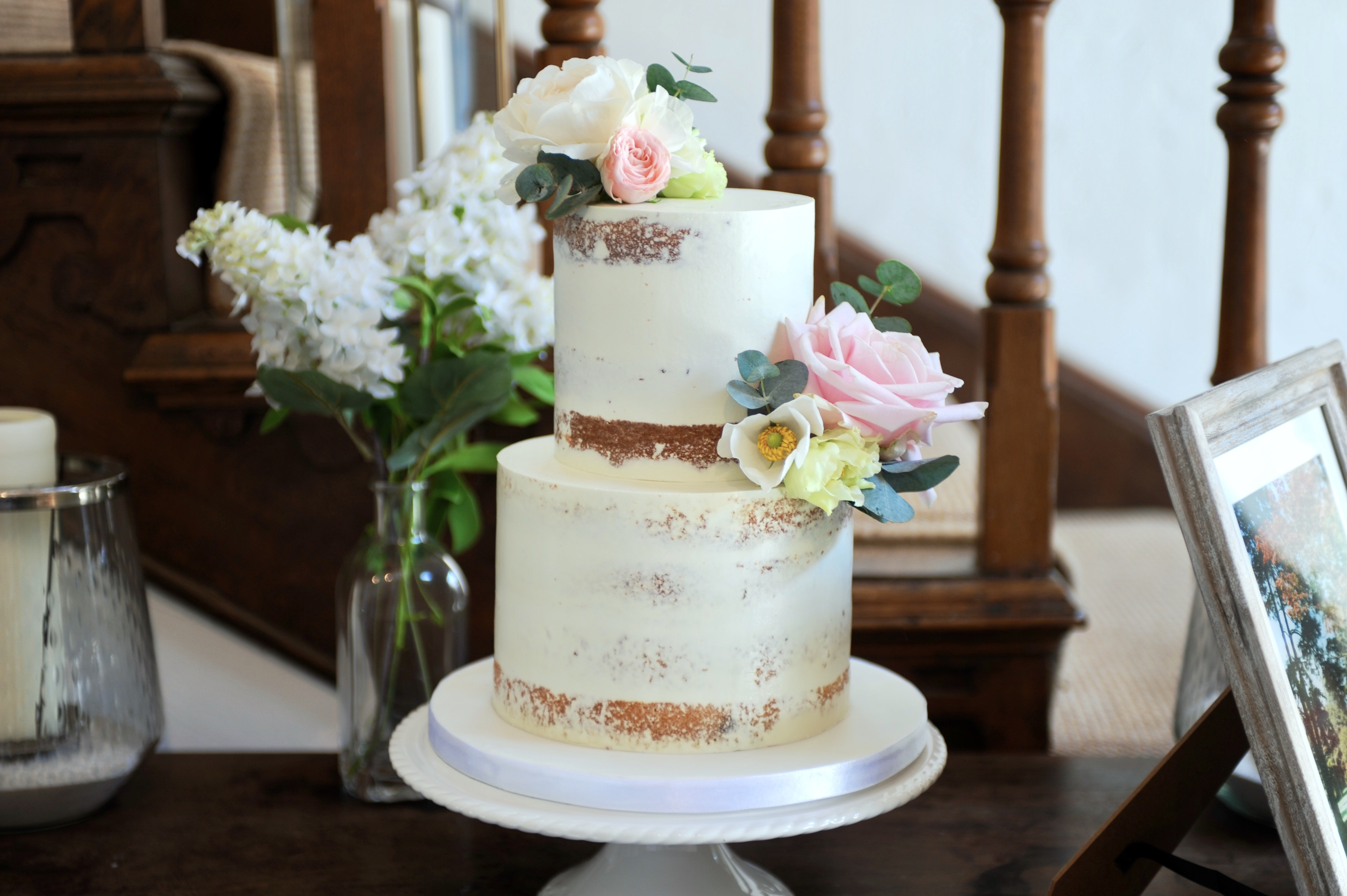 A two tier semi naked wedding cake